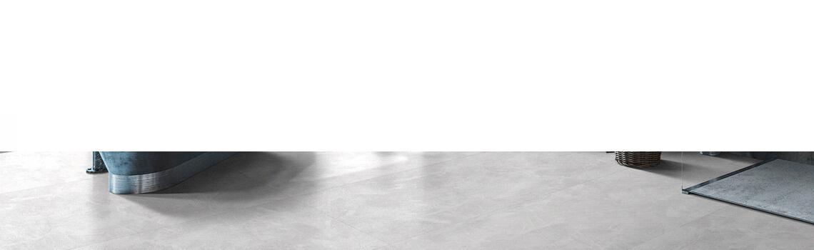 Techlam® Nomad White 5mm de espesor 1500x1000 cm. La elegancia de paredes y suelos de cemento fratasado es la base del diseño deTechlam® Nomad White