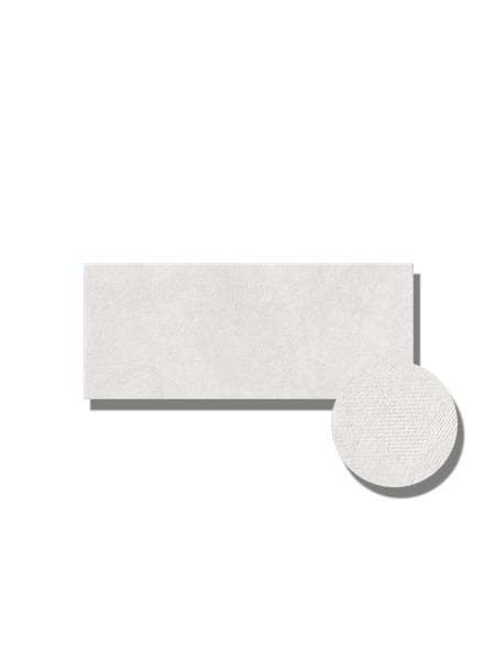 Revestimiento Ibiza White mate 25x60 cm. Una serie de azulejo para paredes imitación cemento texturizado con decoración con formas geométricas.