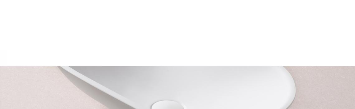 Lavabo Solid Surface ovalado Vernazza 58 x 33 x 15 cm. Un lavabo con bonita forma estilizada fabricado en brillo o mate en Solid Surface.