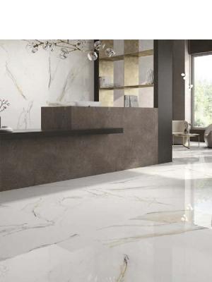 Pavimento porcelánico rectificado Atlantis Gold pulido 60 x 120 cm.Un azulejo para suelos y paredes que imita al mármol Calacatta Gold.