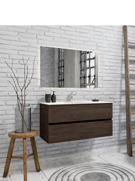 Mueble de baño suspendido Vica 100 Wood nogal 2 cajones en acabado Wood nogal mate. Un mueble de baño de apertura suave por uñero con encimera para grifo sobre encimera y seno centrado.