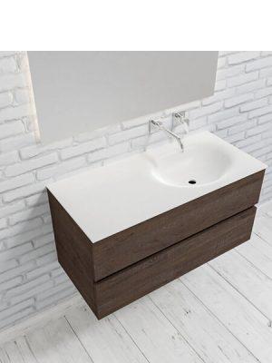 Mueble de baño suspendido Vica 100 Wood nogal 2 cajones en acabado Wood nogal mate. Un mueble de baño de apertura suave por uñero con encimera para grifo empotrado y seno derecho.