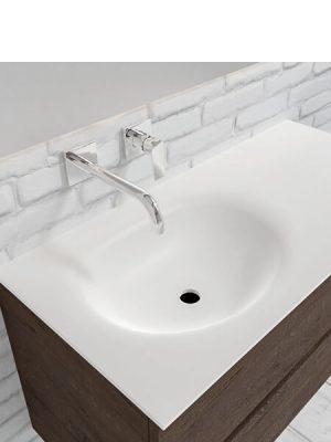 Mueble de baño suspendido Vica 100 Wood nogal 2 cajones en acabado Wood nogal mate. Un mueble de baño de apertura suave por uñero con encimera para grifo empotrado y seno izquierda.