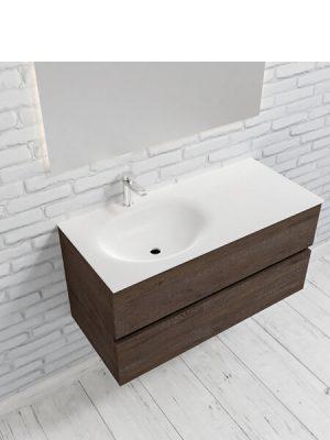 Mueble de baño suspendido Vica 100 Wood nogal 2 cajones en acabado Wood nogal mate. Un mueble de baño de apertura suave por uñero con encimera para grifo sobre encimera y seno izquierda.