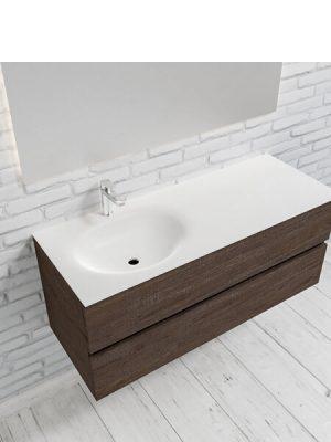 Mueble de baño suspendido Vica 120 Wood nogal 2 cajones en acabado Wood nogal mate. Un mueble de baño de apertura suave por uñero con encimera para grifo sobre encimera y seno izquierda.