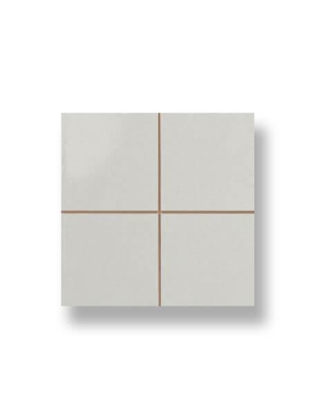 Revestimiento precorte 10x10 pasta roja liso gris 20x20 cm. Un azulejo fácil de instalar y que te ofrecerá el aspecto de un azulejo 10x10 cm.