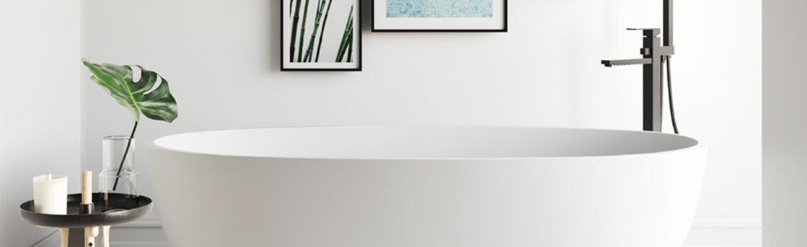 Bañeras exentas Solid Surface. Bañera de libre instalación con rebosadero interno. Una bañera de líneas rectas pero con una frágil curvatura.